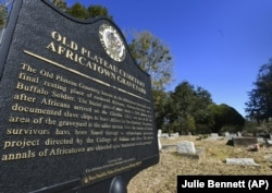 Old Plateau Cemetery, the final resting place for many who spent their lives in Africatown, stands in need of upkeep near Mobile, Ala. Many of the survivors of the slave ship Clotilda's voyage are buried here among the trees.