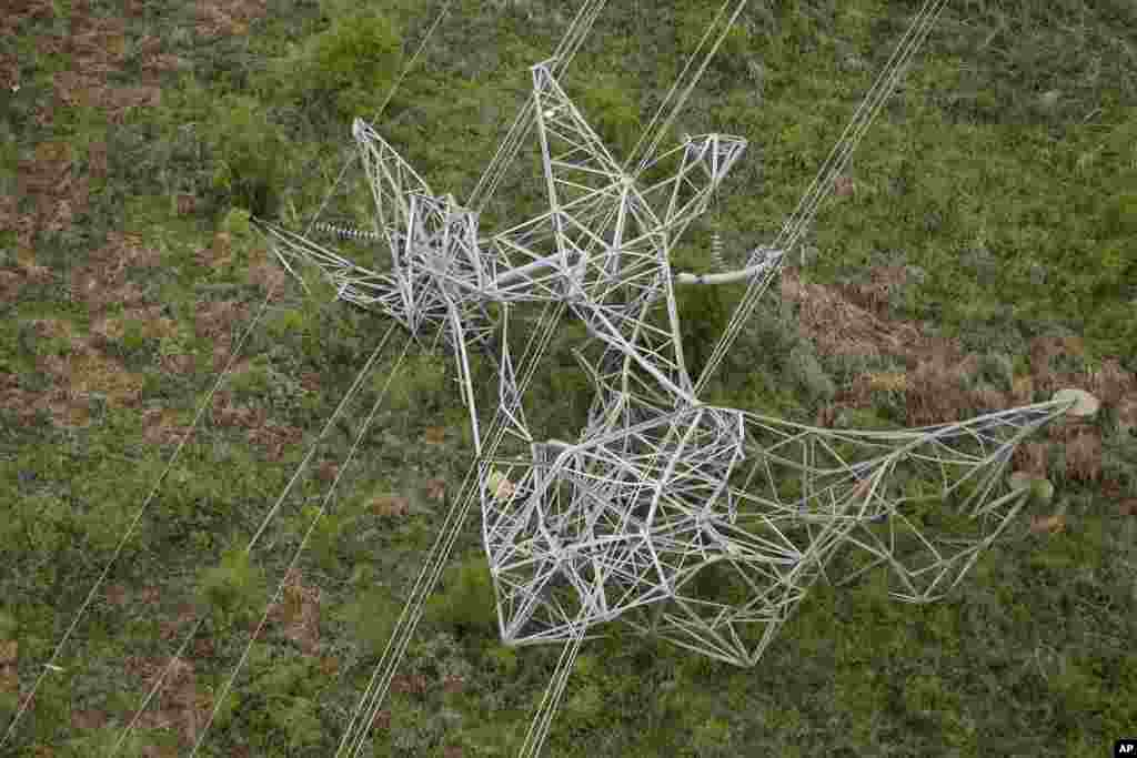 An electricity distribution tower was toppled over after a tornado system ripped through several states, near Mayflower, Arkansas, April 28, 2014.