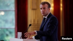 FILE - French President Emmanuel Macron delivers a speech during the annual French ambassadors' conference at the Elysee Palace in Paris, France, Aug. 27, 2018.
