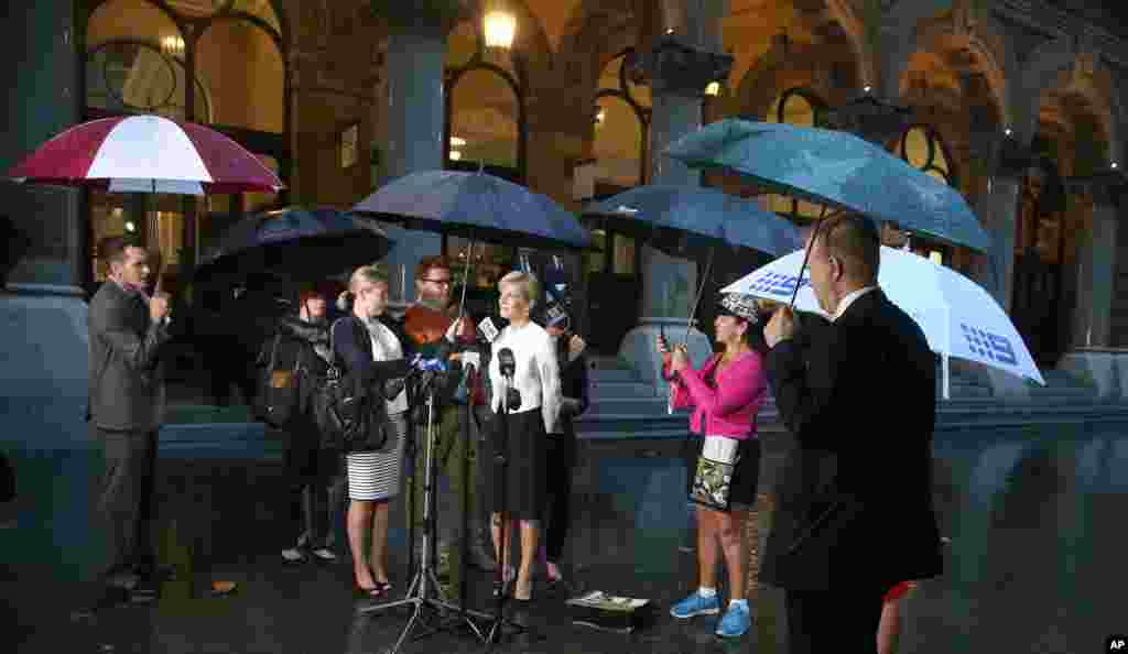 Julie Bishop, Australia's Minister for Foreign Affairs, stands in the rain as she comments on the release of journalist Peter Greste from an Egyptian jail, Sydney, Australia, Feb. 2, 2015.