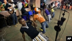 FILE - Youths dance in the a rap band entertaining meeting of the National Youth Council, Jan. 4, 2013. In Cameroon, authorities are banning the sale or broadcast of some popular music including a new dance hit by the prominent Cameroonian rapper, Franko.