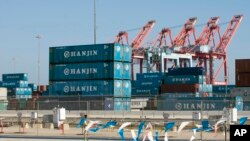 FILE - South Korea's Hanjin Shipping Co. containers are seen in the Port of Long Beach, Calif., Sept. 1, 2016.