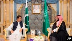 In this photo released by the state-run Saudi Press Agency, Pakistani Prime Minister Imran Khan, left, meets Saudi Crown Prince Mohammed bin Salman, Sept. 19, 2018, in Jiddah, Saudi Arabia.
