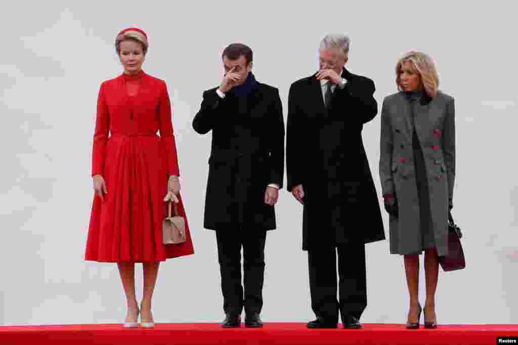Belgian King Philippe and Queen Mathilde welcome French President Emmanuel Macron and his wife Brigitte Macron at Brussels' Royal Palace, on the first day of an official state visit, in Brussels, Belgium.