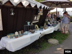 Crafts on display included beadwork, glassware, prints, dolls and pottery.
