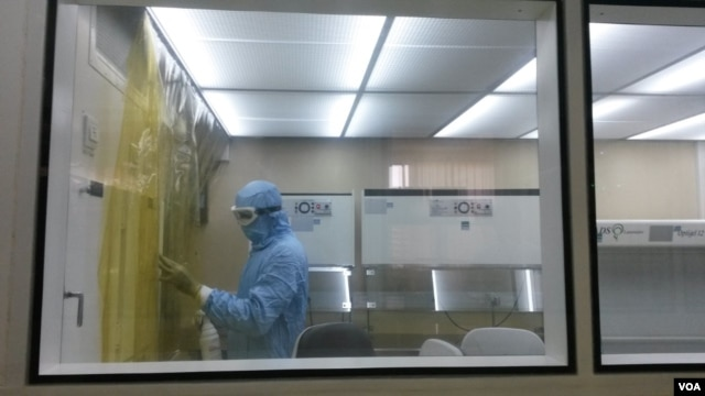 A technician at the Institut Pasteur in Dakar, Senegal, sterilizes one of the labs where the yellow fever vaccine is made. (VOA / J. Lazuta)