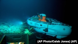 The Pisces IV submersible sits on top of Cook seamount, as seen from the Pisces V craft, during a dive to the previously unexplored underwater volcano off the coast of Hawaii's Big Island on Sept. 6, 2016. Seamounts are places scientists are finding new species. (AP Photo/Caleb Jones)
