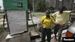 A man buys fuel at a petrol station in Lagos, Nigeria, April 24, 2012.