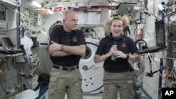 In this image made from video provided by NASA, astronaut Kate Rubins (R) speaks during an interview aboard the International Space Station, July 13, 2016.