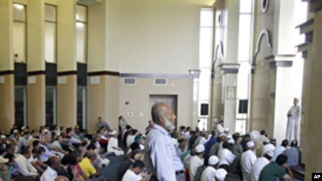 Worshipers listen to the sermon in the main hall of the Noor Islamic Center in Dublin, Ohio, Aug. 26, 201.