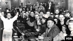 Citizens in a bar celebrate the end of alcohol prohibition in the United States, December 5, 1933.