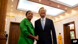 FILE - U.S. National Security Advisor Susan Rice, left, shakes hands with Chinese State Councilor Yang Jiechi at the Diaoyutai State Guesthouse in Beijing, China, Aug. 28, 2015.