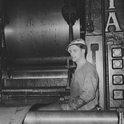 A steel worker at a rolling mill in Pittsburgh, Pennsylvania