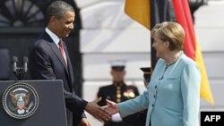 .Tổng thống Obama (trái) tiếp Thủ tướng Ðức Angela Merkel tại Tòa Bạch Ốc
