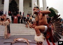 Chickahominy Indian Preston Adkins preforms a ritual dance for Va. Gov. Jim Gilmore, during the annual tax tribute at the Capitol in Richmond, Va., Wednesday Nov. 24, 1999. Virginia Indian tribes have been paying the annual tax tribute since the treaty of