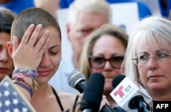 Marjory Stoneman Douglas High School student Emma Gonzalez reacts during her speech at a rally for gun control at the U.S. Courthouse in Fort Lauderdale, Fla., Feb. 17, 2018.