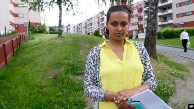 Hiwet Tesfamariam Berhe holds photocopies of documents she told the Associated Press belong to her brother Medhane Tesfamariam Berhe, in Oslo, June 9, 2016. Berhe said that her brother was misidentified as Medhane Yehdego Mered, an Eritrean man accused of trafficking thousands of Africans to Italy.