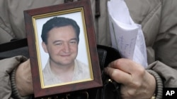 Portrait of lawyer Sergei Magnitsky who died in Russian jail. The US Senate has approved legislation that would end four-decades-old trade restrictions, but also imposes sanctions on Russian human rights violators, December 6, 2012.