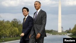 FILE - U.S. President Barack Obama and Japanese Prime Minister Shinzo Abe visit the Lincoln Memorial in Washington, with Washington Monument in the background, April 27, 2015.