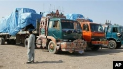 Afghanistan-bound NATO trucks are parked at a roadside as authorities blocked NATO supply line to Afghanistan after NATO allegedly killed three border guards at Pakistani border, at tribal check post of Takhta Beg in Khyber area of Pakistan near Pak-Afgha