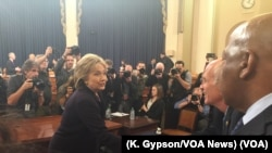 Former U.S. Secretary of State Hillary Clinton greets people following her morning testimony before the House Select Committee on Benghazi on Capitol Hill, Oct. 22, 2015.