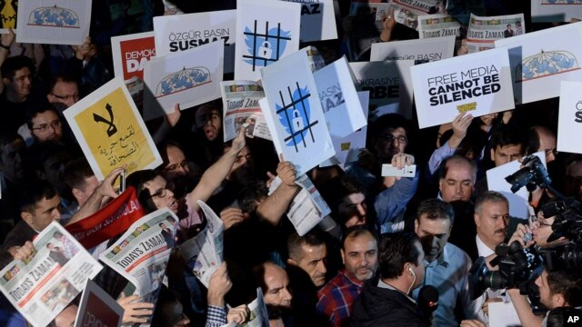 FILE - People rally in support of press freedom in Istanbul, Turkey, Oct. 9, 2015.