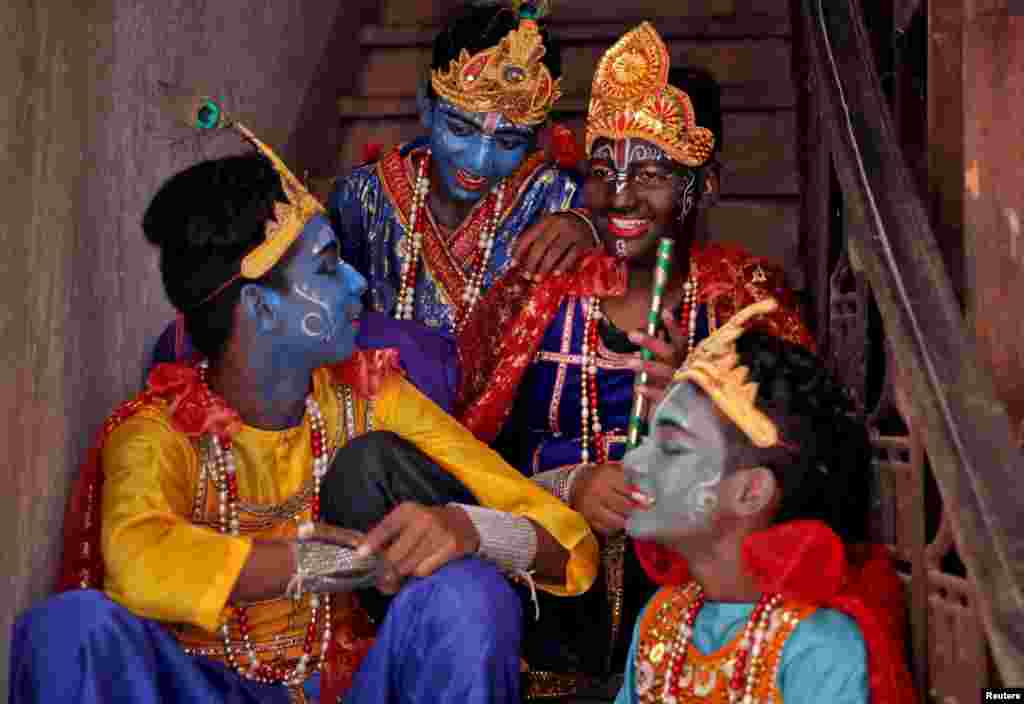 Boys dressed as Hindu Lord Krishna wait to perform at a temple during the festival of Janmashtami, marking the birth anniversary of Lord Krishna, in Kolkata, India.