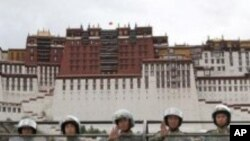 People's Armed Police officers patrol in front of the Potala Palace