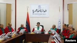 President of Libya's Supreme Court Kamal Edhan (C) chairs a hearing to discuss the legitimacy of Prime Minister Ahmed Maiteeq in Tripoli, Libya, June 9, 2014.