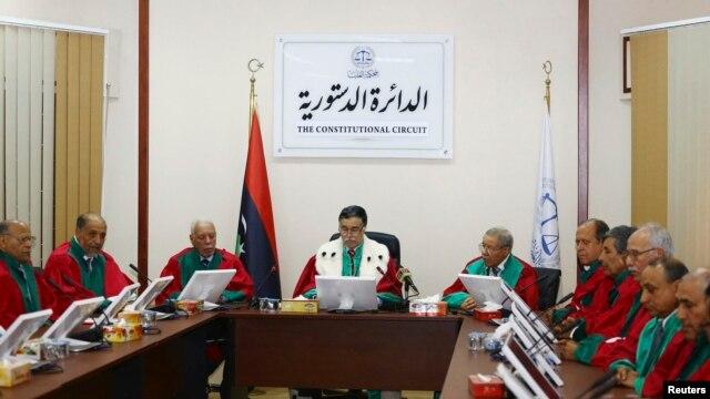 President of Libya's Supreme Court Kamal Edhan (C) chairs a hearing to discuss the legitimacy of Prime Minister Ahmed Maiteeq in Tripoli, Libya, June 9, 2014.