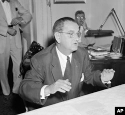 FILE - In this July 30, 1954, file photo, then-Sen. Lyndon Johnson, D-Texas, holds a news conference in Washington. The amendment named for him is a provision in the U.S. tax code that prohibits all 501(c)(3) nonprofits from endorsing or opposing political candidates.