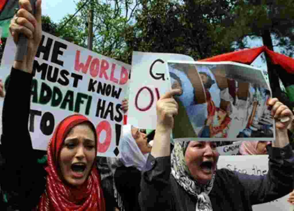 Libyan protesters shout slogans against Libyan leader Gadhafi in front of the Libyan embassy in Kuala Lumpur on February 23, 2011.