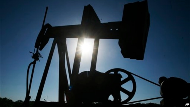 An oil well pumps under the summer sun in a field near Rantoul, Kan., Friday, July 1, 2011. (AP Photo/Orlin Wagner)