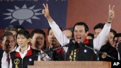 Taiwanese President Ma Ying-jeou declares his victory in the presidential election, Saturday, Jan. 14, 2012, in Taipei, Taiwan. Ma won a close re-election fight, leveraging his message of greater prosperity through expanded ties with China to beat his pop