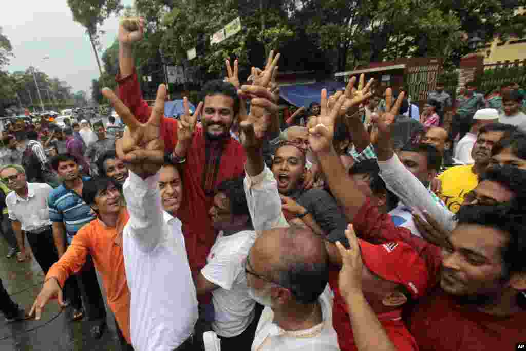 Activists shout slogans and celebrate the verdict against Jemaat-e-Islami party leader Abdul Quader Mollah in Dhaka, Bangladesh, Sept. 17, 2013.
