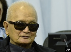 In this photo released Cambodia's war crimes court, Khmer Rouge leader Nuon Chea listens to testimony during his trial in Phnom Penh, Mar. 20, 2012.