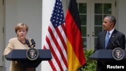Predsednik Obama i nemačka kancelarka Angela Merkel u govore o krizi u Ukrajini u Beloj kući, 2. maja 2014.