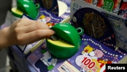 100 yen coin in a frog-shaped piggy bank