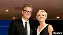 FILE - MSNBC's Joe Scarborough and Mika Brzezinski arrive for the annual White House Correspondents' Association dinner in Washington, April 25, 2015.