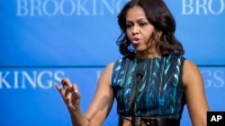 """Michelle Obama speaks about """"mobilizing for children's rights, supporting local leaders and improving girls' education"""", Dec. 12, 2014, at the Brookings Institution in Washington."""