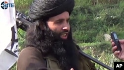 FILE - This undated image provided the SITE Intel Group, an American private terrorist threat analysis company, shows Mullah Fazlullah in Pakistan.