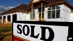 FILE -- A sold sign is posted in front of a new home in Springfield, Illinois.