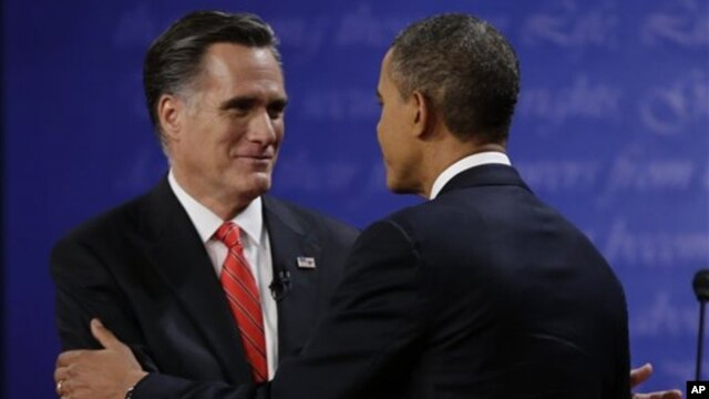 Republican presidential nominee Mitt Romney (L) shakes hands with President Barack Obama following the first presidential debate at the University of Denver, October 3, 2012, in Denver.