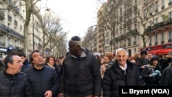Patrick Meyer, center, walks with friends and fellow members of France's Jewish community.