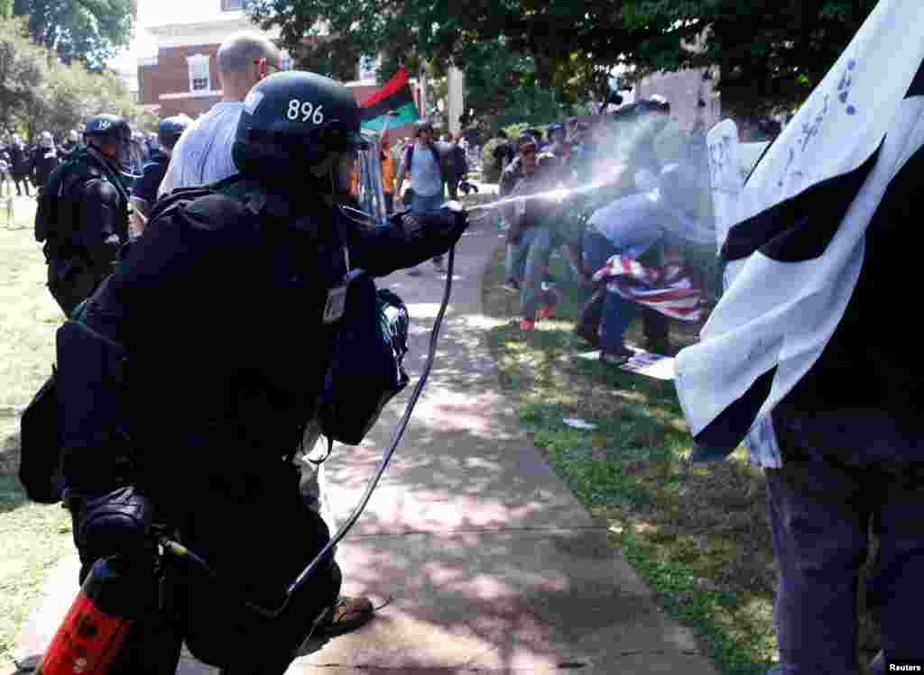 Virginia State Police use pepper spray as they move in to clear a clash between members of white nationalist protesters against a group of counterprotesters in Charlottesville, Va., Aug. 12, 2017.