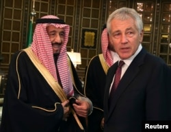 U.S. Secretary of Defense Chuck Hagel is greeted by Saudi Crown Prince Salman bin Abdulaziz (L) in Riyadh, Dec. 9, 2013.