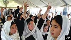 Afghan school girls studying under a tent in Kabul (AP)