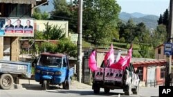 A vehicle covered with electoral posters moving around the Albanian capital Tirana, May 6, 2011