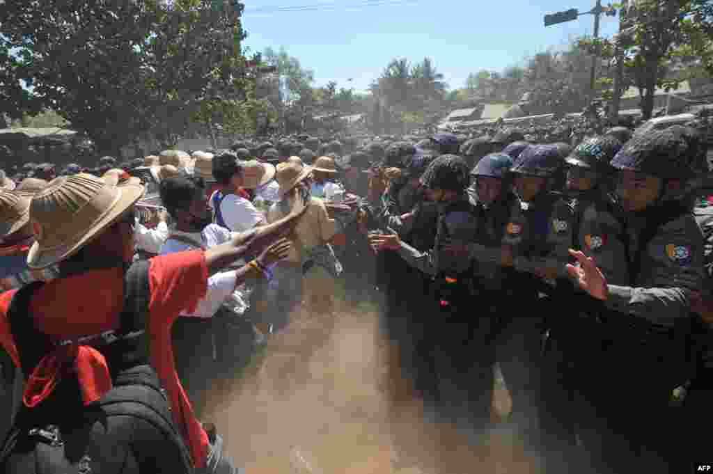 Myanmar riot police confront students during a protest march against an education bill in Letpadan town, some 130 kilometers (80 miles) north of Yangon.