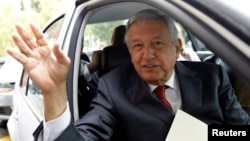 Andres Manuel Lopez Obrador, presidential pre-candidate of the National Regeneration Movement (MORENA), waves as he leaves an event during which he unveiled his anti-corruption plan he will put in place if he wins this year's election, in Mexico City, Jan